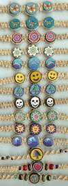 JewelryVilla Hemp chokers with fimo beads, hemp necklaces with fimo beads, smiley faces, skulls, mushrooms, flowers, butterflys, ocean waves, hearts